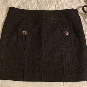Black skirt with two buttons on the front
